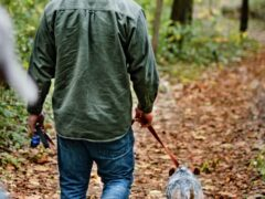 Man walking a dog on a leash