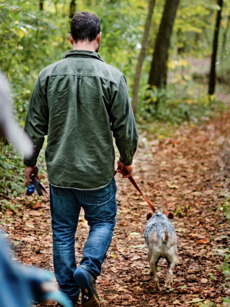 Man walking a dog on a leash