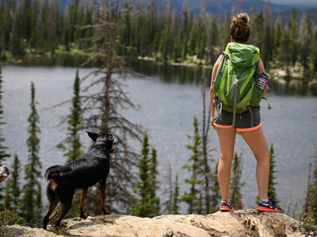 Women hiking with her dog